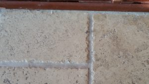 cleaned travertine tile and grout lines