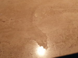 travertine counter top etch marks